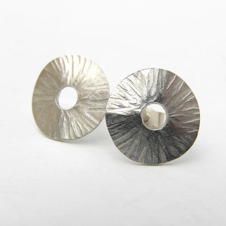 Radiant silver stud earrings
