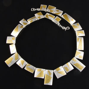 Silver and gold necklace by Cathy Timbrell