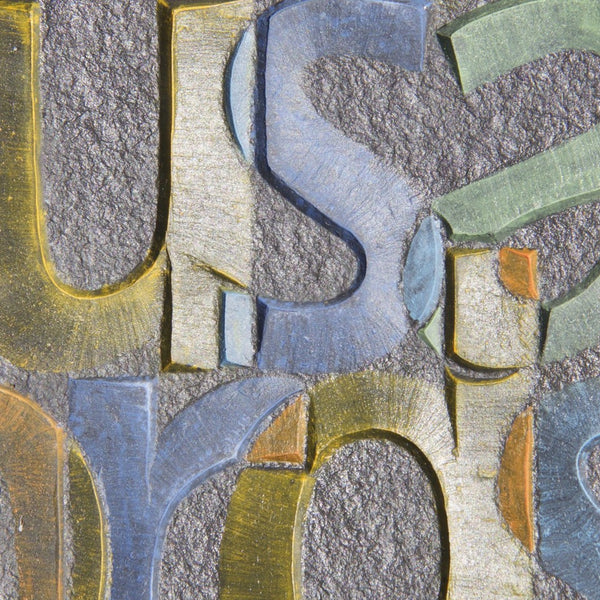 A picture paints  -  Burlington Grey flame textured slate carved and painted by Annet Stirling