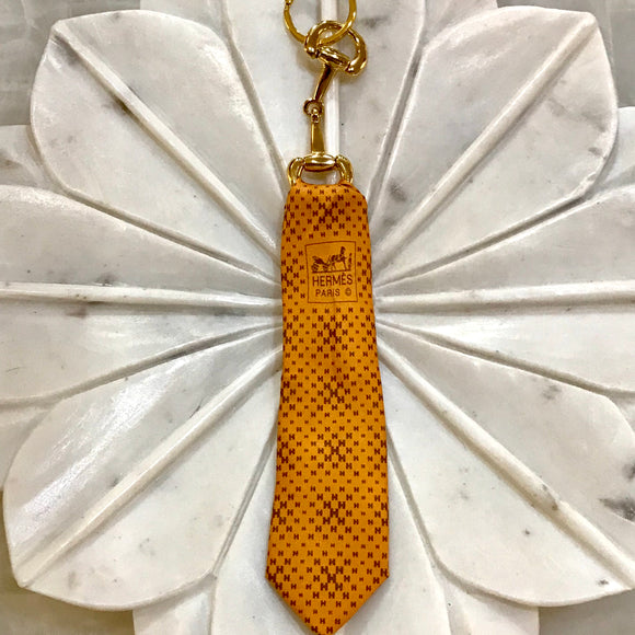 orange brown Hermes tie keychain