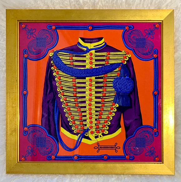 uniform in purple, yellow, red, and blue framed Hermes luxury scarf designer