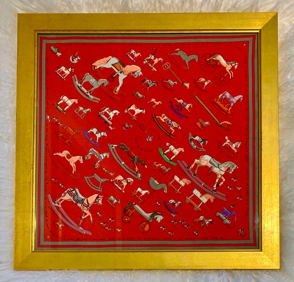 toy horses red background framed designer Hermes scarf