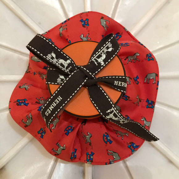toy horses blue red background hermes designer scrunchie luxury