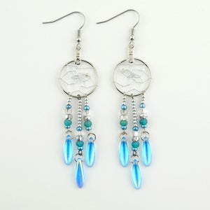 "Handwoven dream catcher earrings beautifully decorated with turquoise picasso glass daggers. Dream Catcher ring size is .75""."