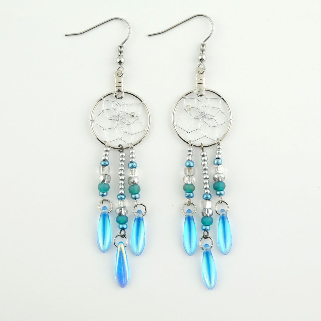 Handwoven dream catcher earrings beautifully decorated with turquoise picasso glass daggers. Dream Catcher ring size is .75