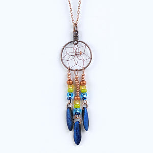 "Handwoven dream catcher necklace beautifully decorated with blue glass daggers. Dream Catcher ring size is .75"". Necklace Length is 18""."