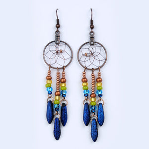 "Handwoven dream catcher earrings beautifully decorated with blue glass daggers. Dream Catcher ring size is .75""."