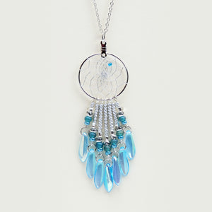 "Handwoven dream catcher web pendant beautifully decorated with turquoise glass daggers and beads. Dream Catcher ring size is 1"". Necklace length is 18""."