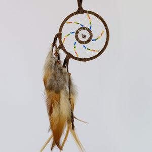 Handmade beaded prismatic dream catcher detailed with a red goldstone semi-precious stone enclosed in a web in the midddle of the web.