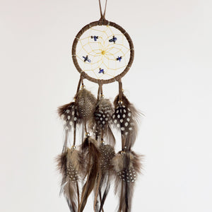 "2.5"" Dream Catcher, in brown hide, detailed with lapis semi-precious stones and gold metallic beads"