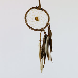 "2.5"" Natural Twig Dream Catchers with Raw Tiger's Eye Semi-precious Stone in the middle of the web."