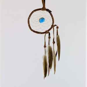 "2.5"" Natural Twig Dream Catchers with Raw Turquoise Semi-precious Stone in the middle of the web."