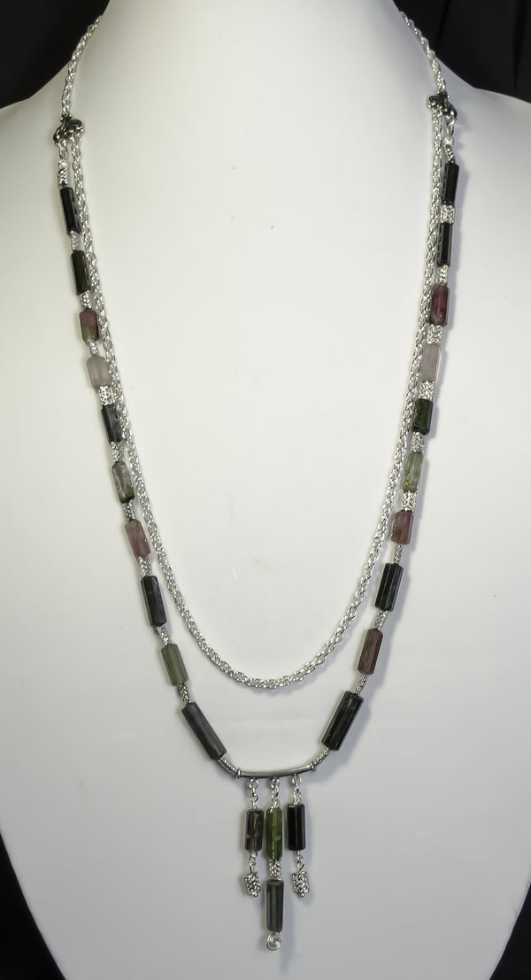 tourmaline faceted tubes (approx 127 carats), sterling silver focal bar and clasp. sp beads and chain