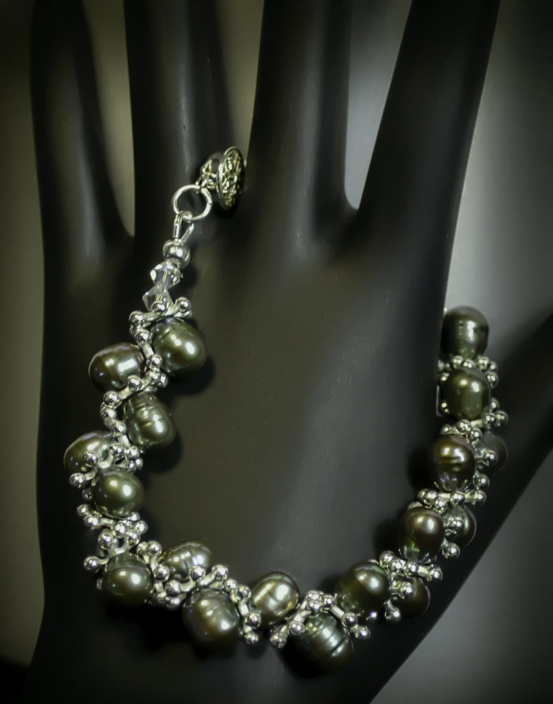 Fresh water pearls, swarovski crystals, sterling silver clasp, sp flakes