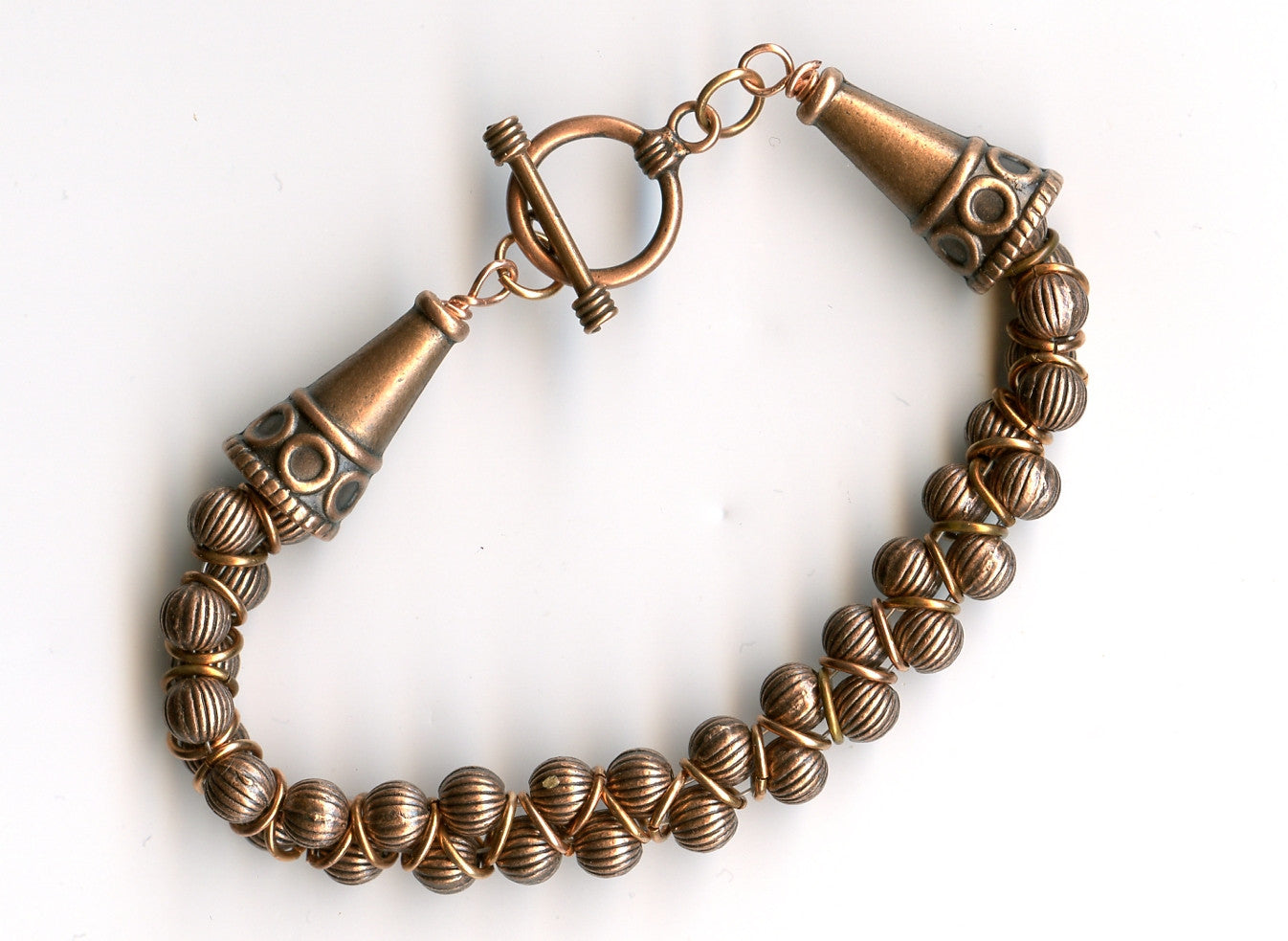 Antiqued Copper beads and cones, copper toggle clasp