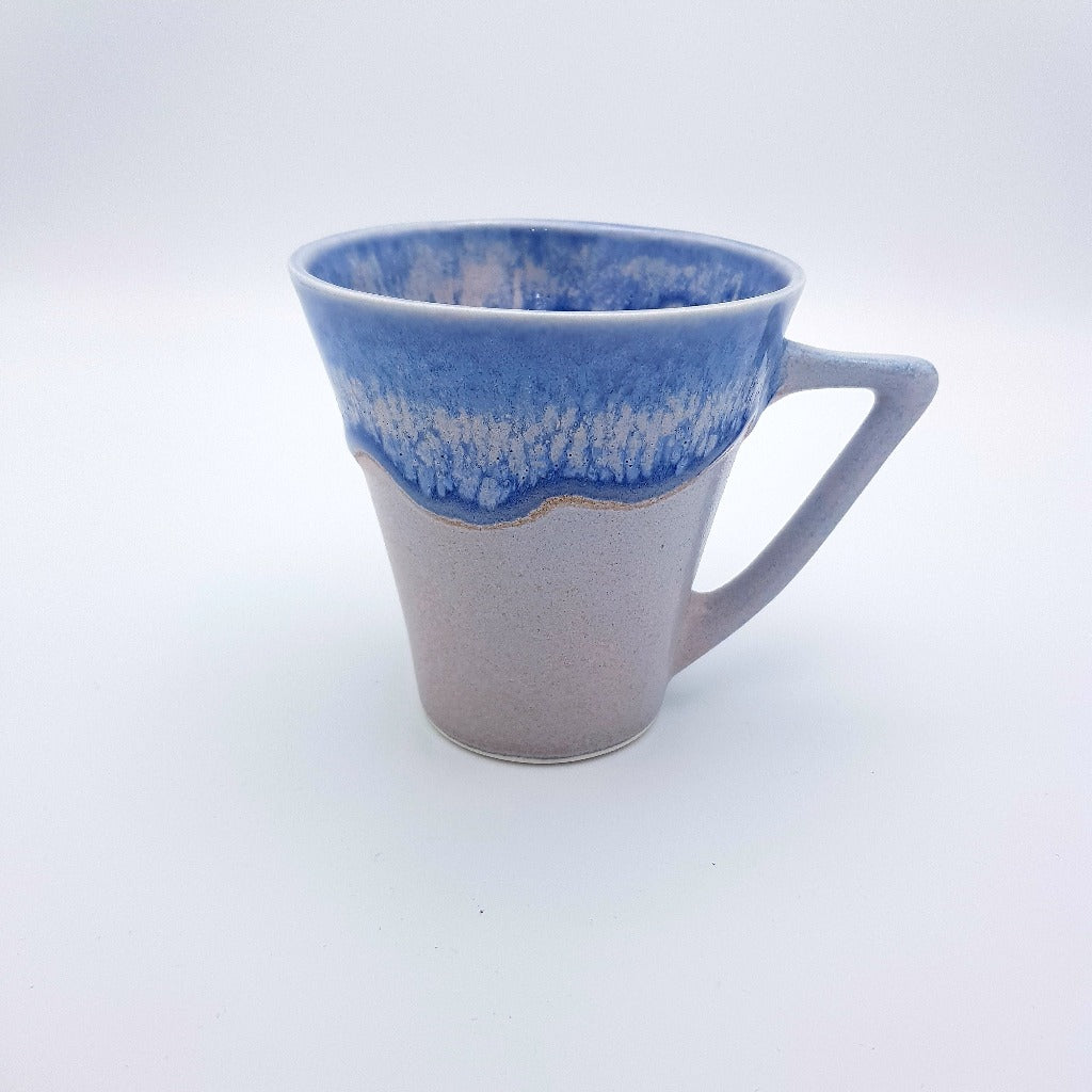 "Kaolin - Iceramic. Cone cup with ""Melting ice"" glaze.e"""
