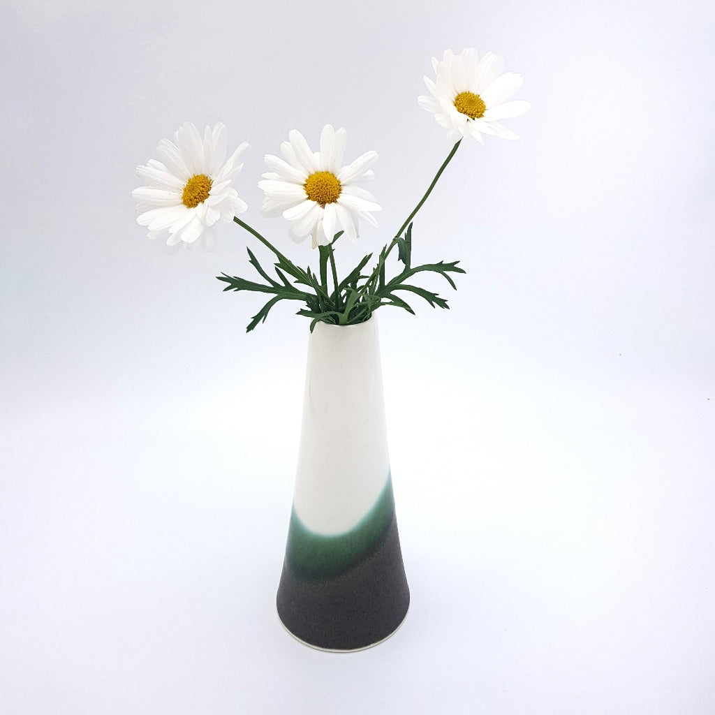 Kaolin - Iceramic. The Top is a flower vase and a kandleholder all in one. The glaze is specially made by the artist and is inspired by the lava fields in Iceland covered by the moss.