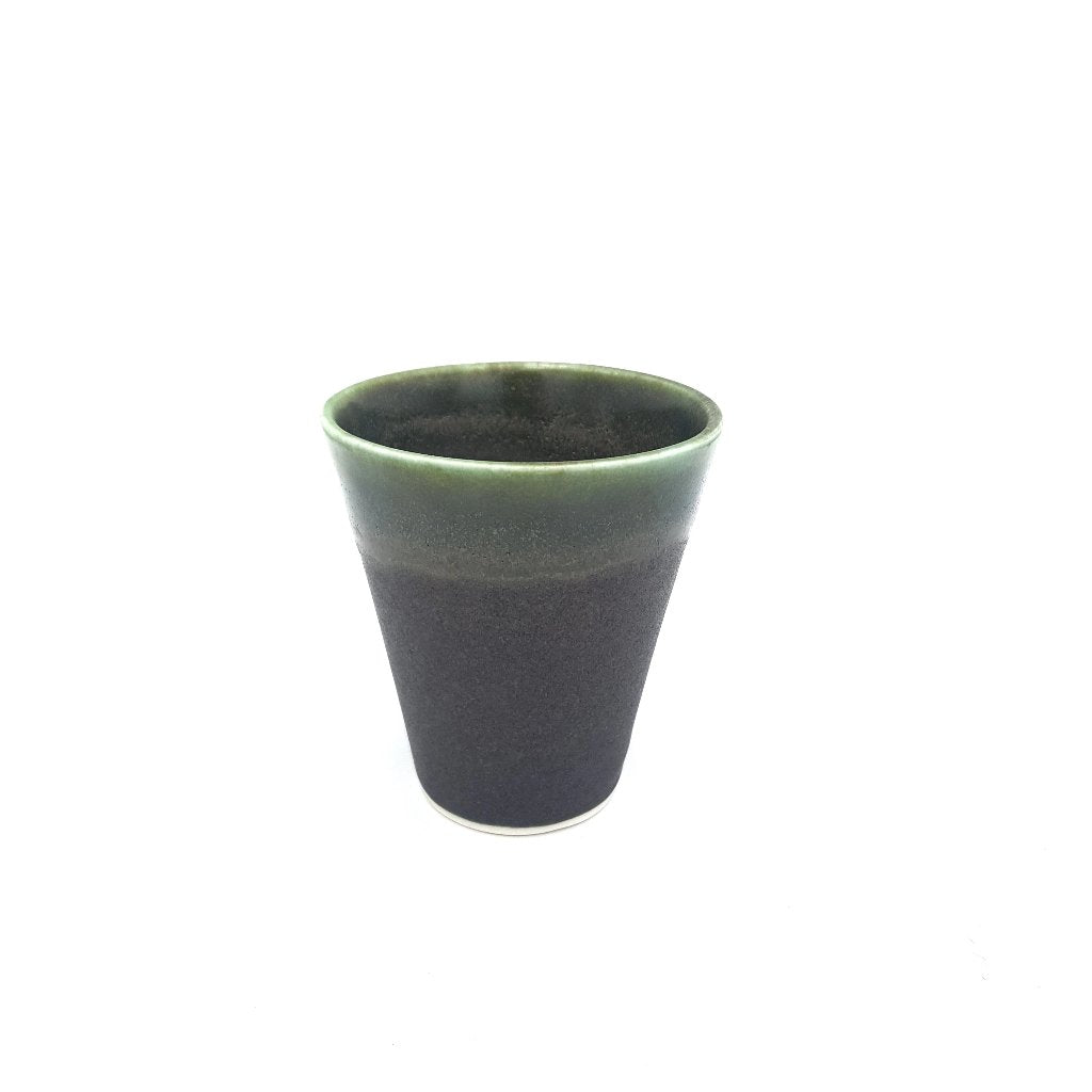 Kaolin - Iceramic. Coffee cup with Black beach glaze.
