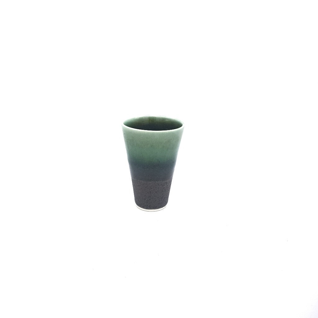Kaolin - Iceramic. Espresso cup with Black beach glaze.