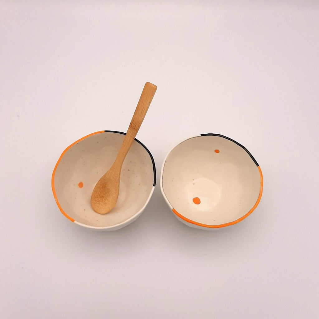 Kaolin - Guðný Magnúsdóttir - ICE CREME is a set of two small porcelain bowls, each with its own small differences and hand painted with black and red lines on the edge.