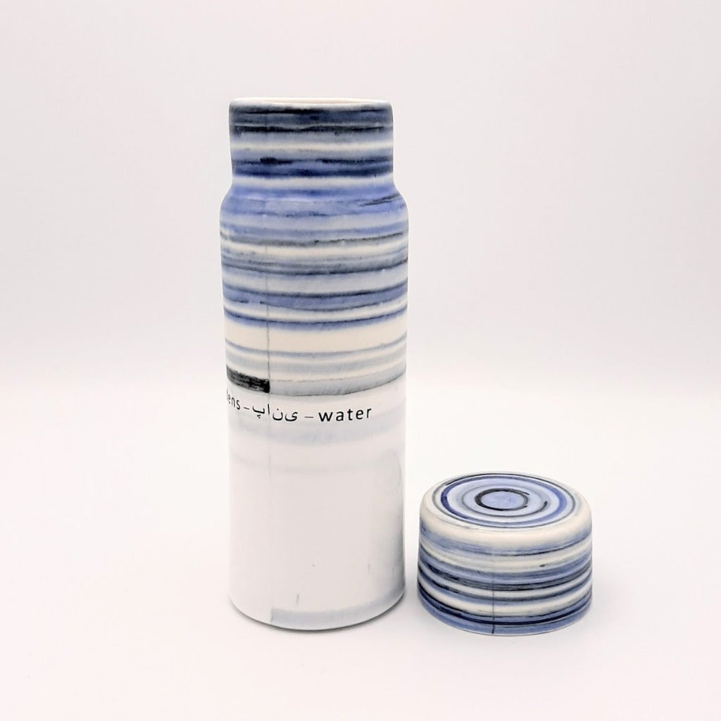 Kaolin - Guðný Magnúsdóttir - H2o WATER KARAFE - are designed in remembrance of the importance of water for all living creatures, the text says water in different languages. MORNING- a bottle in a blue combinations. The bottle comes with a cap.