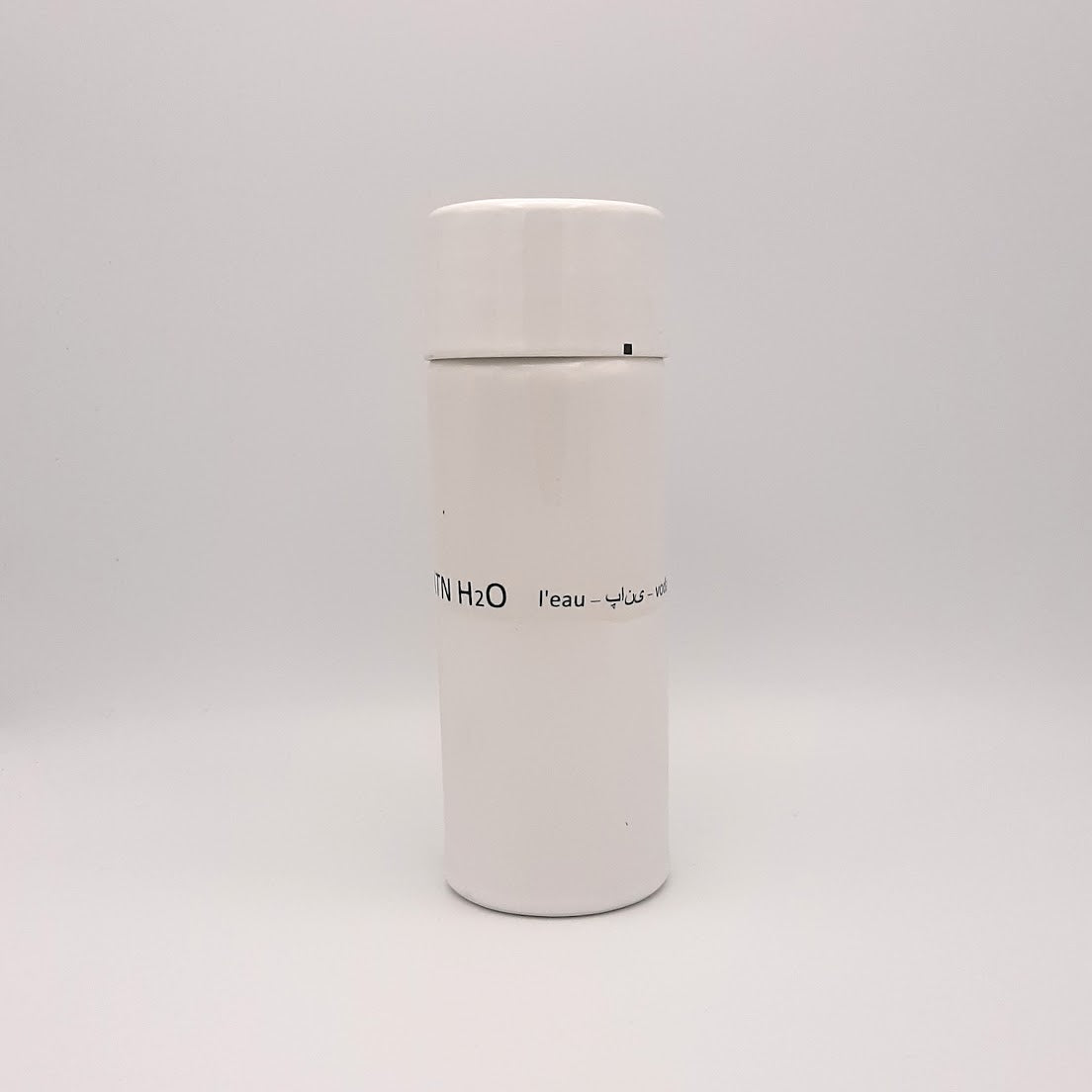 Kaolin - Guðný Magnúsdóttir - H2o WATER KARAFE - are designed in remembrance of the importance of water for all living creatures, the text says water in different languages. ICE - a water bottle in two white glazes. The water bottle comes with a cap.