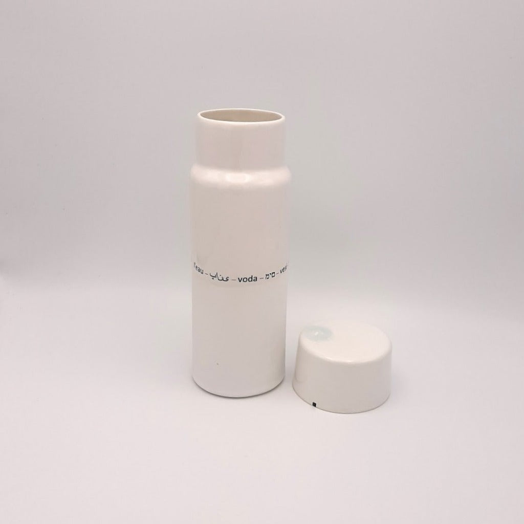 Kaolin - Guðný Magnúsdóttir - H2o WATER KARAFE - are designed in remembrance of the importance of water for all living creatures, the text says water in different languages. ICE- a water bottle in two white glazes.  The water bottle comes with a cap.