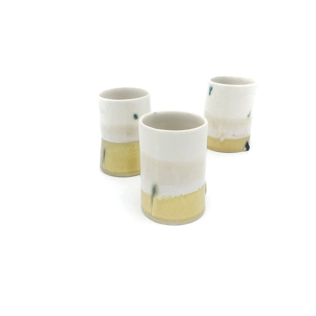 Kaolin-gudnyhaf Porcelain coffiecup/glass-color white and yellow.