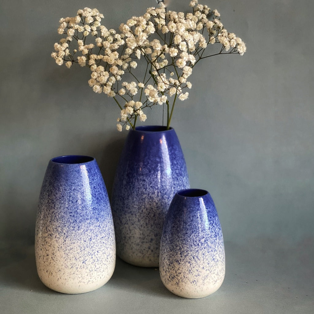 Kaolin - Daynew - Flower vase in blue on top and white on bottom.