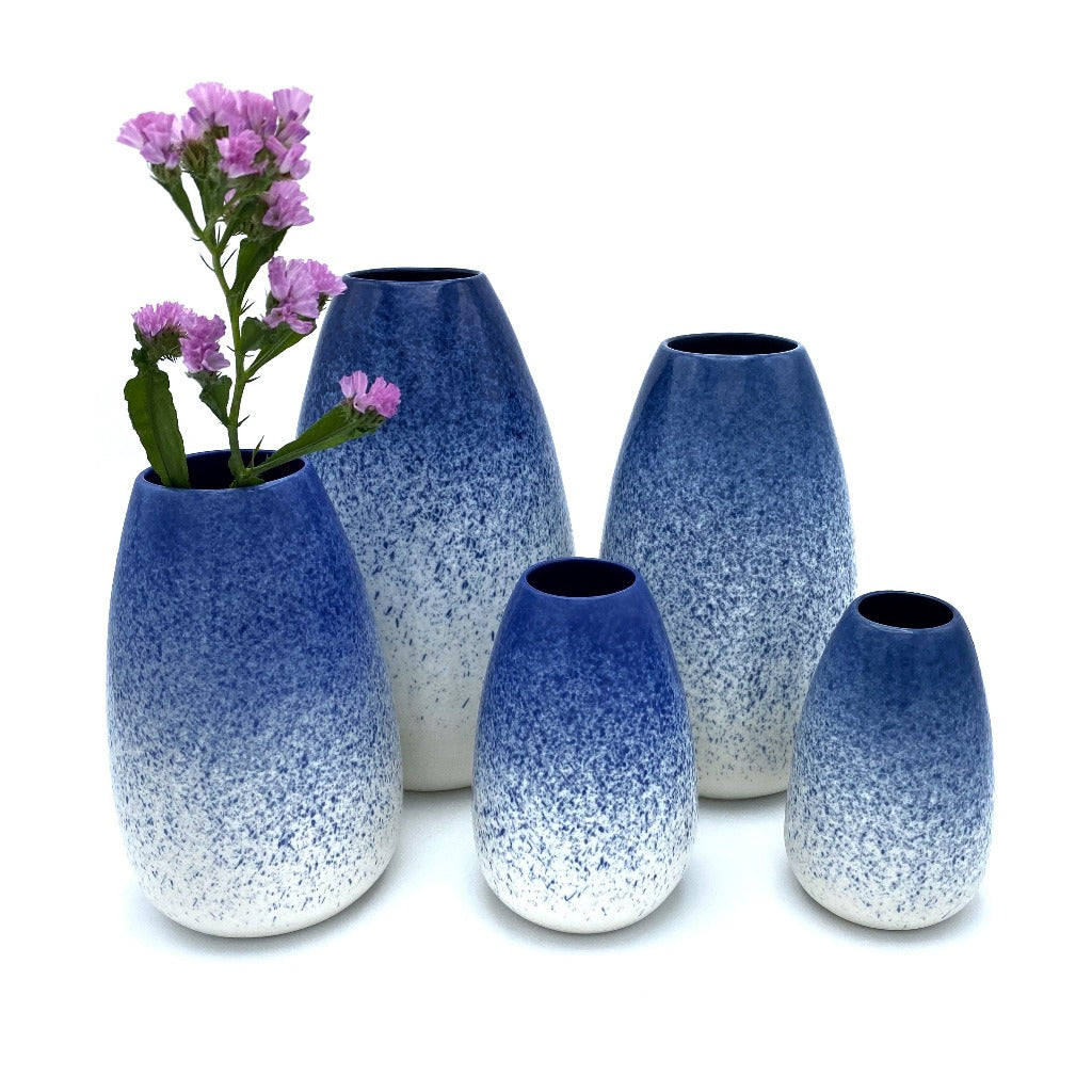 Flower vases in blue on top and white n bottom. They are available in 5 sizes.