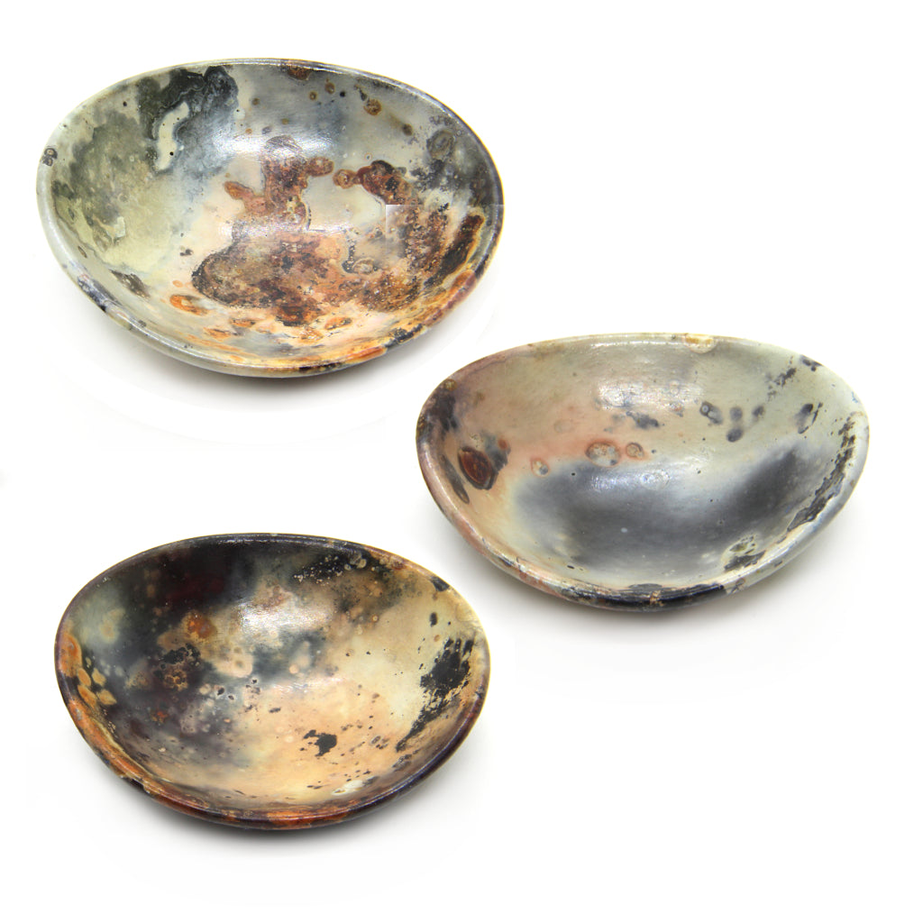 Kaolin - Kvalka - Three randomly selected small and shallow smoke fired handmade ceramic bowls in multicolor.