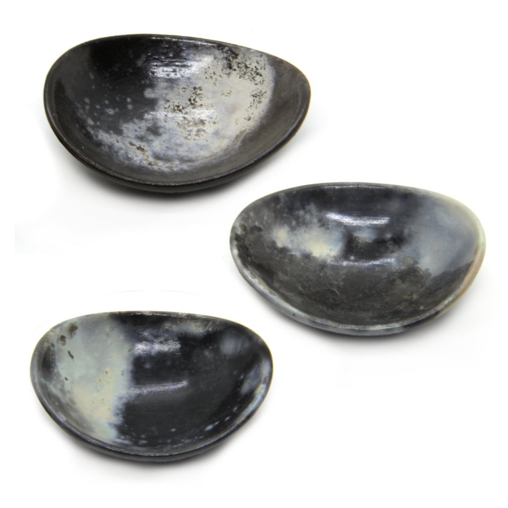 Kaolin - Kvalka - Three randomly selected small and shallow smoke fired handmade ceramic bowls in grey, white and black tones