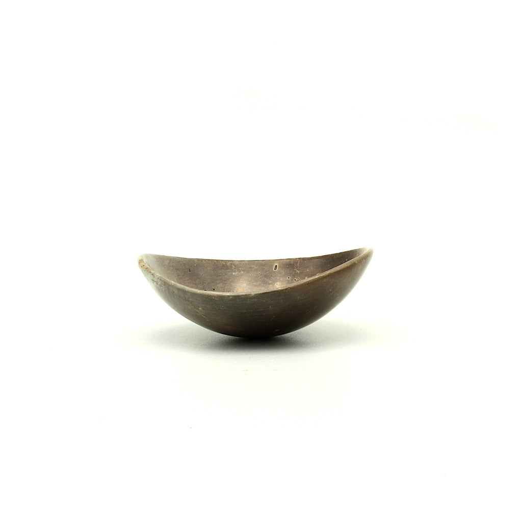 Kaolin - Kvalka -  Small and shallow smoke fired handmade ceramic bowl. The shape of the bowl is like the bottom of a sphere. Color in brown hues