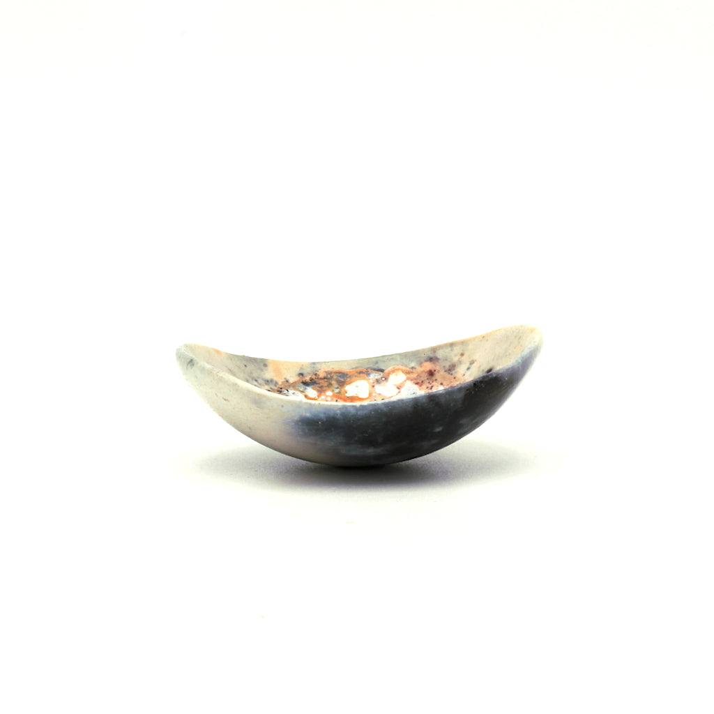 Kaolin - Kvalka - Randomly selected small and shallow smoke fired handmade ceramic bowl. The shape of the bowl is like the bottom of a sphere