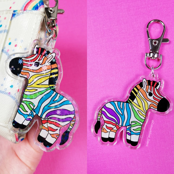 A collage of two photos. The first photo shows the front of the keyring with holographic stars and the printed zebra. The back of the keyring has the printed zebra on it too.