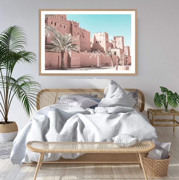 Pastel Pink Moroccan Desert Palace Art Print In a Timber Frame In A Bedroom