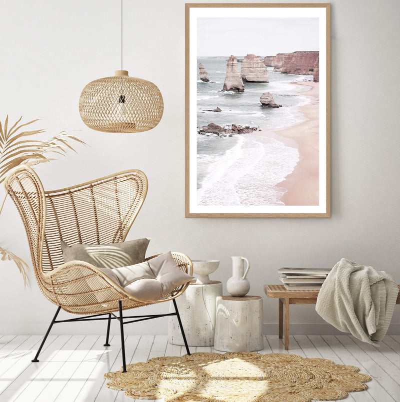 Framed Australian Coast Art Print Of The Great Ocean Road And The Twelve Apostles In A Natural Timber Frame On A Wall In A Sitting Room