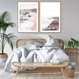 Set Of Great Ocean Road Art Prints, Framed A Natural Timber Frame above a Cane Bed In A Coastal Bedroom