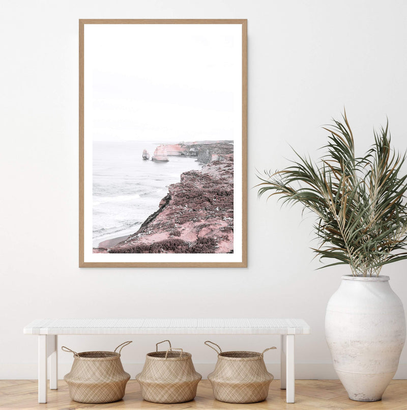 Framed Photograph Art Print Of The Great Ocean Road & The Twelve Apostles in A Natural Timber Frame In A sitting Room Above A White Bench