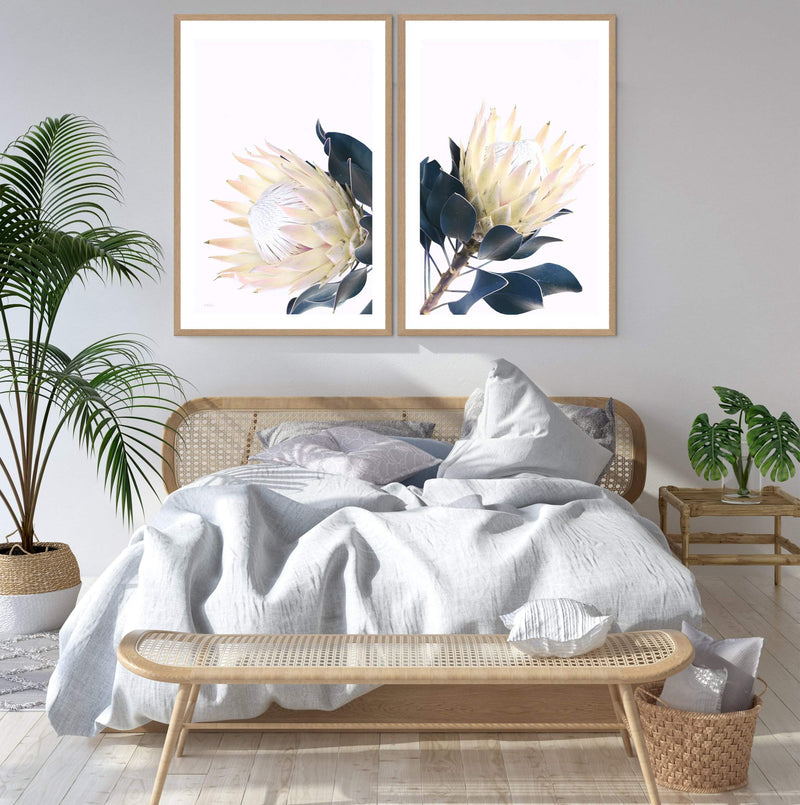 Set Of Two Yellow Protea Art Prints In Timber Frames In a Bedroom
