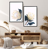 Set Of Two Yellow Protea Art Prints In Black Frames In a Lounge  Room