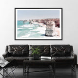 Coastal Art Print Of The Australian Landmark The Great Ocean Road & The Twelve Apostles Framed In A Black Timber Frame In A Living Room