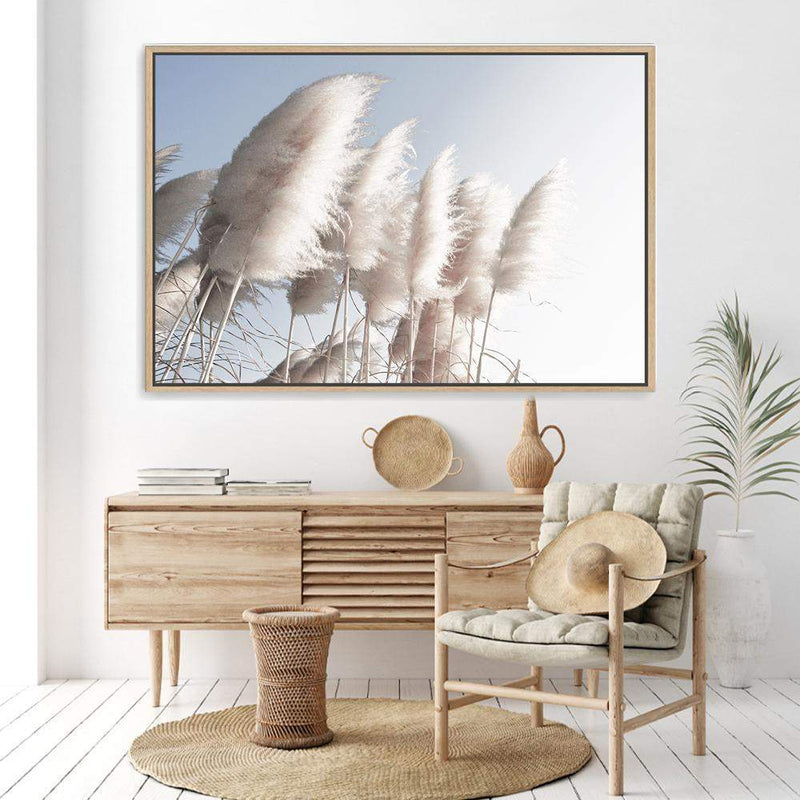 coastal art print featuring a photographed print of tall pampas grass with a neutral beach feel with a Timber frame Displayed above a timber buffet in a sitting room