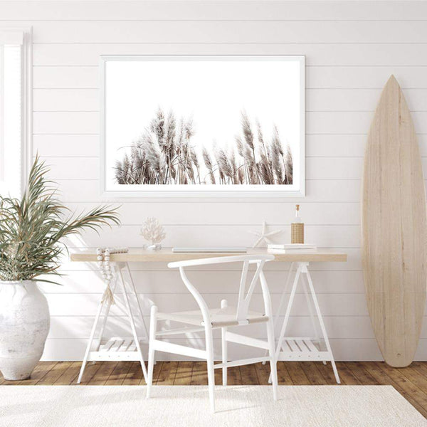 Framed Neutral Coastal Art Print Of Pampas Grass In A White Timber Frame Above A Desk In A Beach House Study