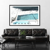 Photographed Print Of The Famous Australian Bondi Beach Ocean Pool In A Black Timber Frame Above A Leather Couch In A Lounge Room