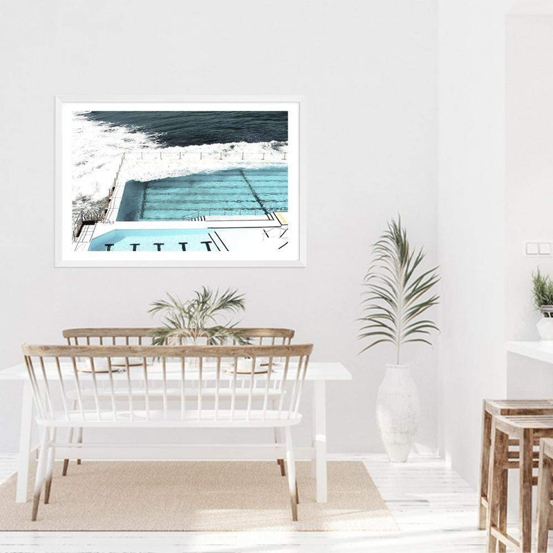 Photographed Print Of The Famous Australian Bondi Beach Ocean Pool In A White Timber Frame Positioned Above A White Weathered Timber Dining Table