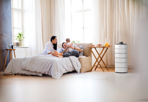family with baby in bedroom with Carrier air purifier