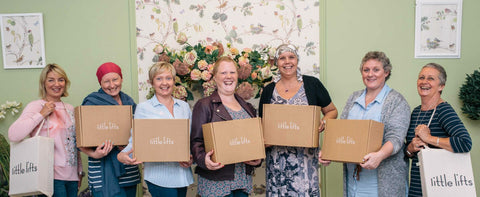 A group of women holding their little lifts boxes