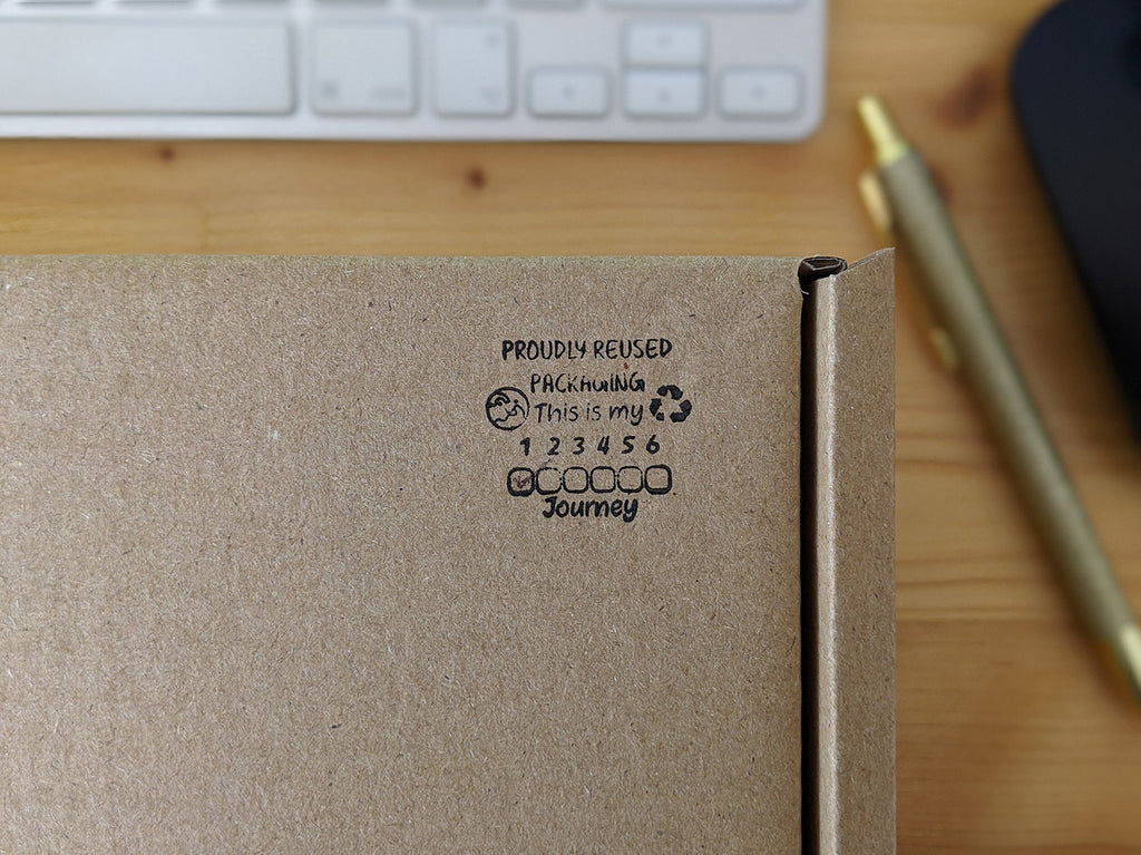 Picture of stamp encouraging people to reuse our boxes