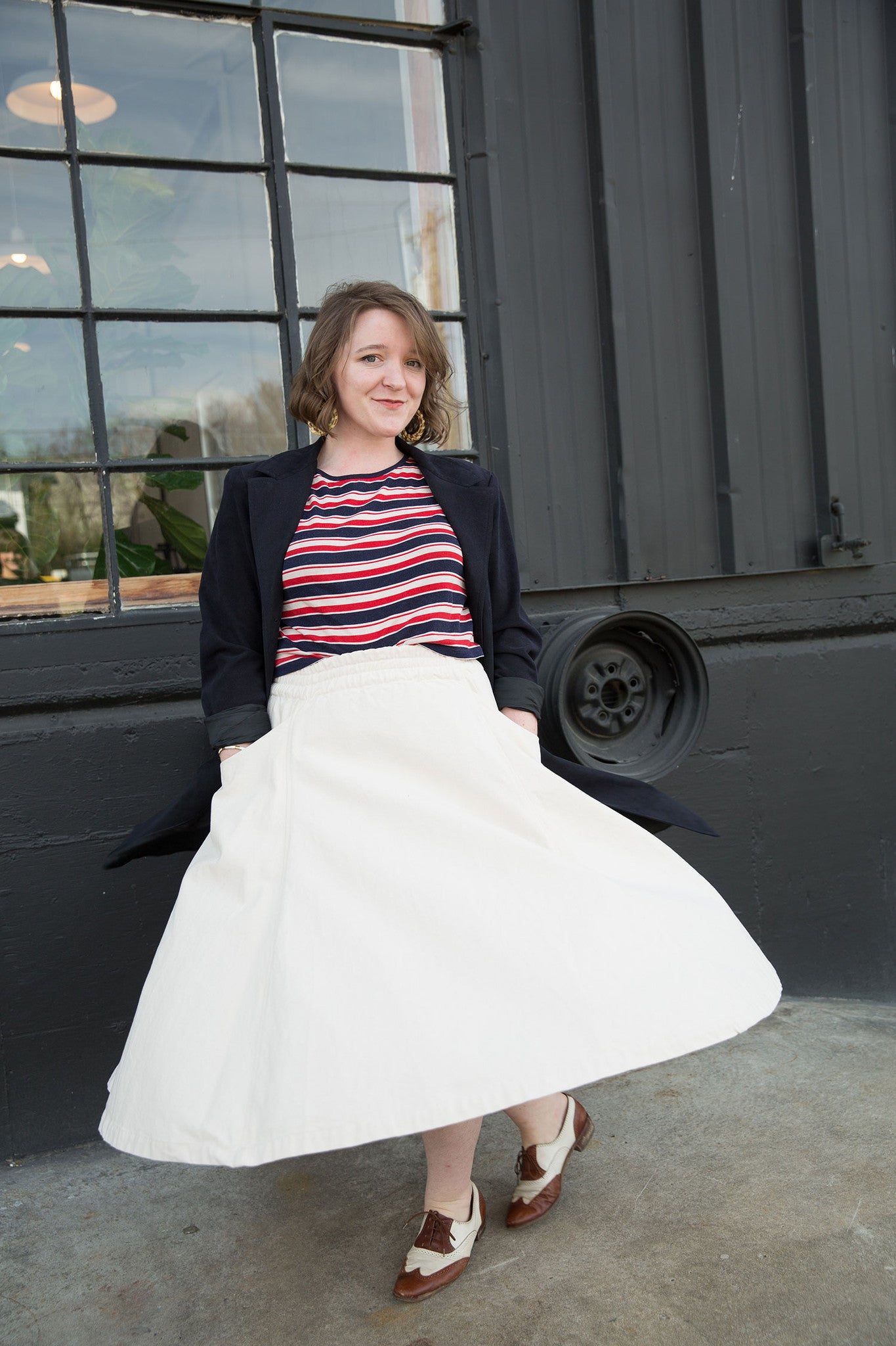 "HOVER2_""The Clyde Billow Skirt in cotton canvas is great for its versatility. I can wear it just as easily with a turtleneck in the winter or with sailor stripes in warmer weather!""[br][br]Chloe is on our Sewing Team and wears the [a href=